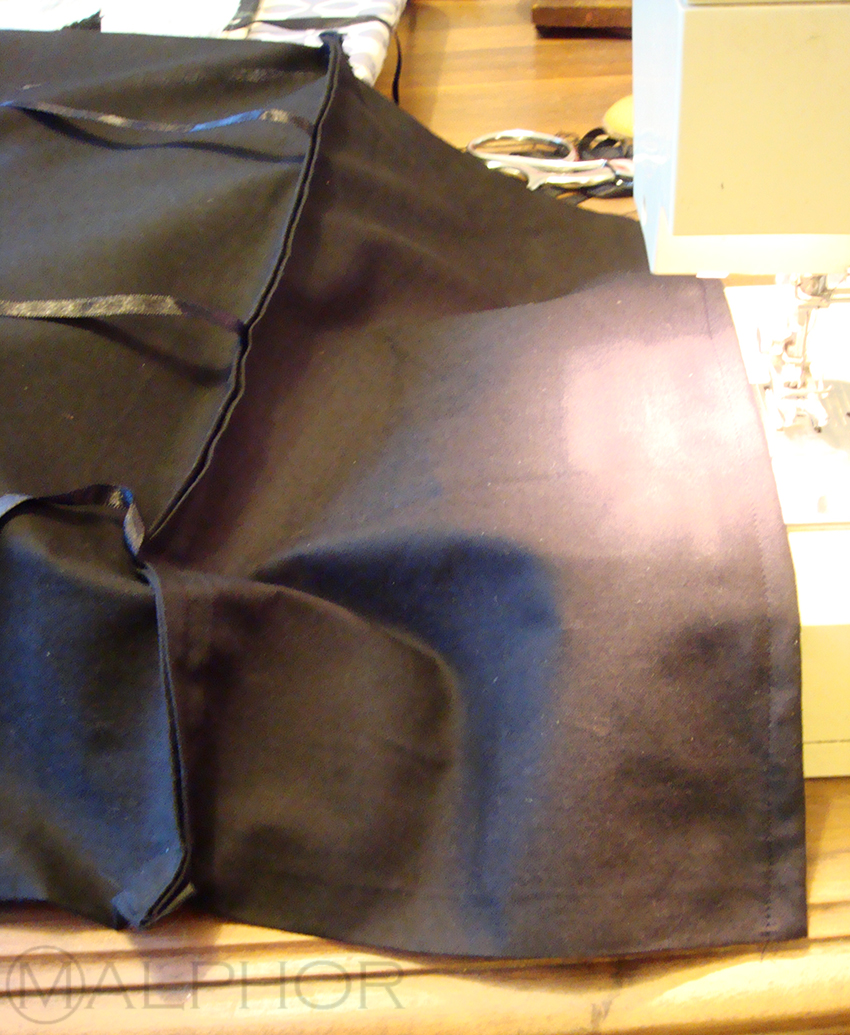 Flap And Ribbons Are Sewn To Black Side
